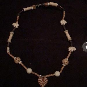 Wooden beaded necklace with hand carved heart